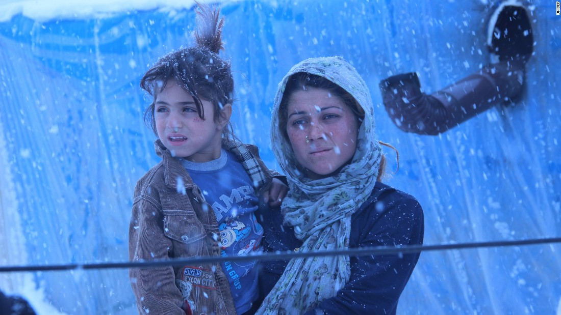 "Winter makes daily life harder in Turkey's refugee settlements, especially for children who lack winter clothing. UNICEF says more than half of all Syrian refugees are children. This young woman whispered to the photographer, ""Send warm clothes, please."""