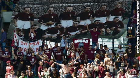 Supporters of Torino FC hold a banner commemorating the players who lost their lives when their plane crashed in the Superga air disaster, on the 65th anniversary of the tragedy last May.