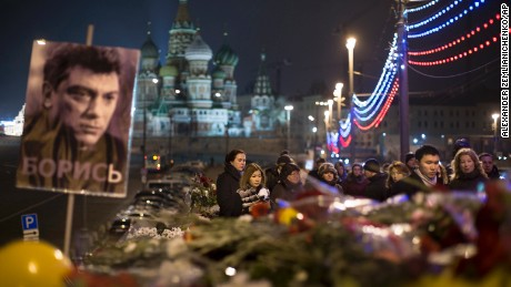 People pay their respects Monday, March 2, at the place where Nemtsov was gunned down in Moscow.