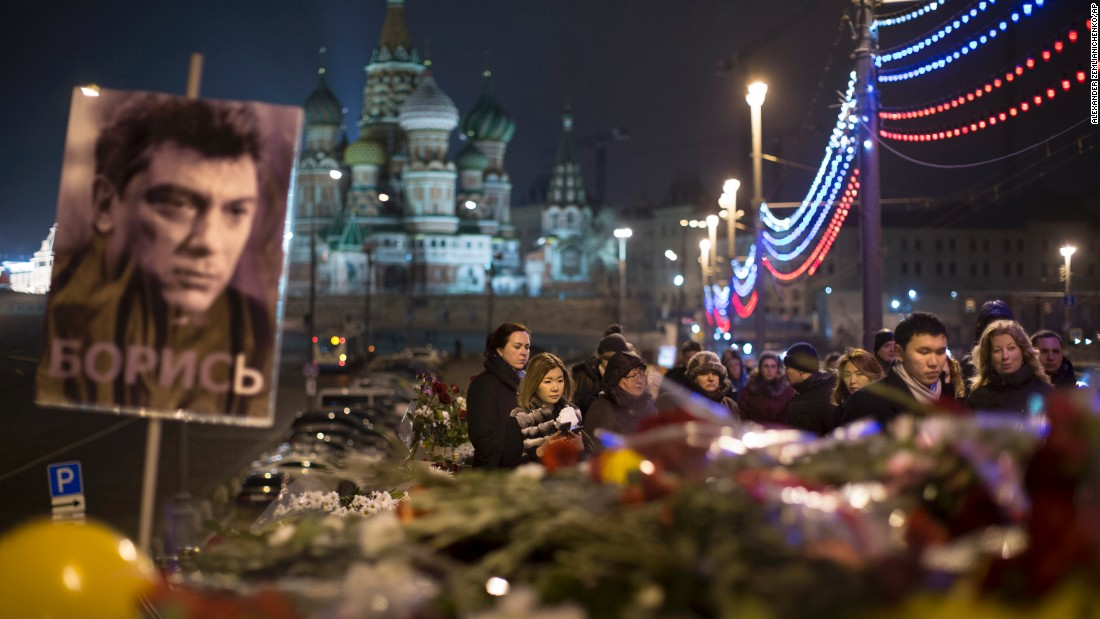 People pay tribute to Nemtsov on Monday, March 2, at the scene of the opposition leader's shooting in Moscow.