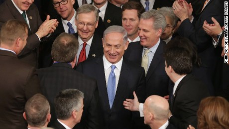 WASHINGTON, DC - MARCH 03: Israeli Prime Minister Benjamin Netanyahu is greeted by members of Congress as he arrives to speak during a joint meeting of the United States Congress in the House chamber at the U.S. Capitol March 3, 2015 in Washington, DC. At the risk of further straining the relationship between Israel and the Obama Administration, Netanyahu warned members of Congress against what he considers an ill-advised nuclear deal with Iran.  (Photo by Chip Somodevilla/Getty Images)