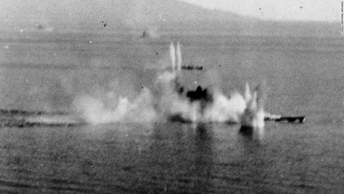 The Japanese battleship Musashi under intense attack by the U.S. Navy's Task Force 38 aircraft in the Sibuyan Sea on October 24, 1944. A destroyer is also receiving attacks beyond the battleship.