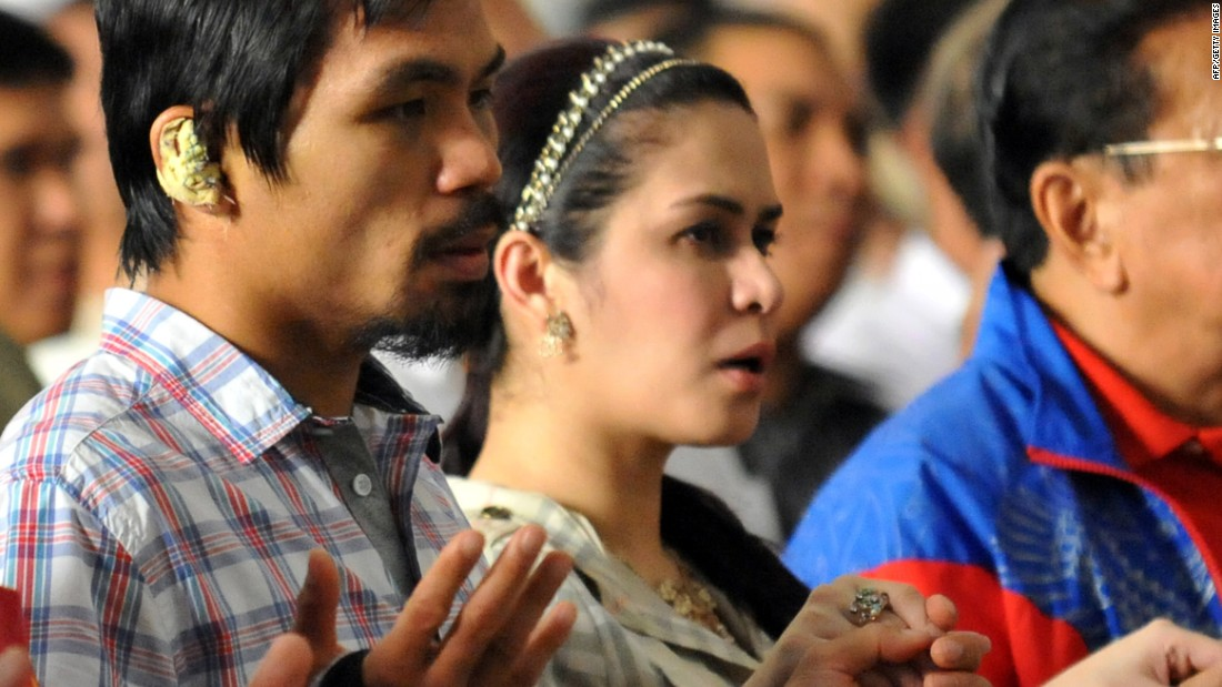 Most of Pacquiao's social media posts evoke his Christian faith and devotion to family. He is photographed with his wife Jinkee during mass in the Quiapo district of Manila on November 20, 2009.