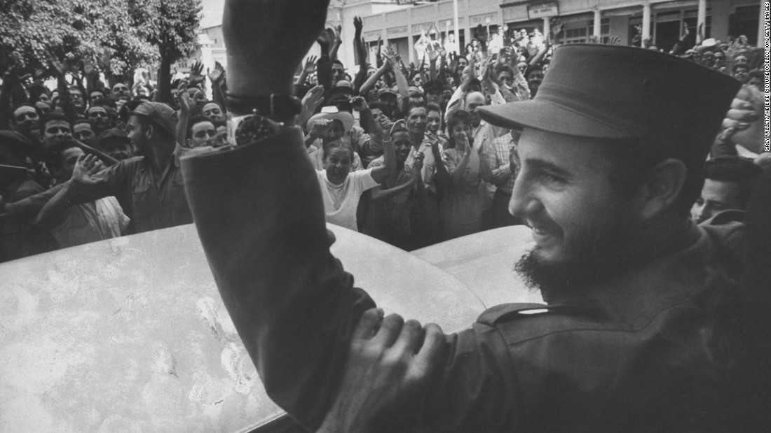 Crowds cheer Castro on his victorious march into Havana in 1959.