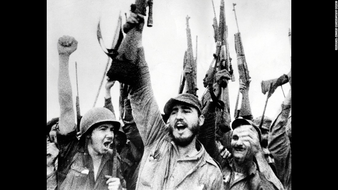Castro and his revolutionaries hold up their rifles in January 1959 after overthrowing Batista.