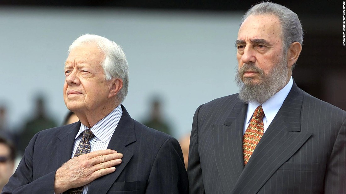 Castro and former US President Jimmy Carter listen to the US national anthem after Carter arrived in Havana for a visit in May 2002.