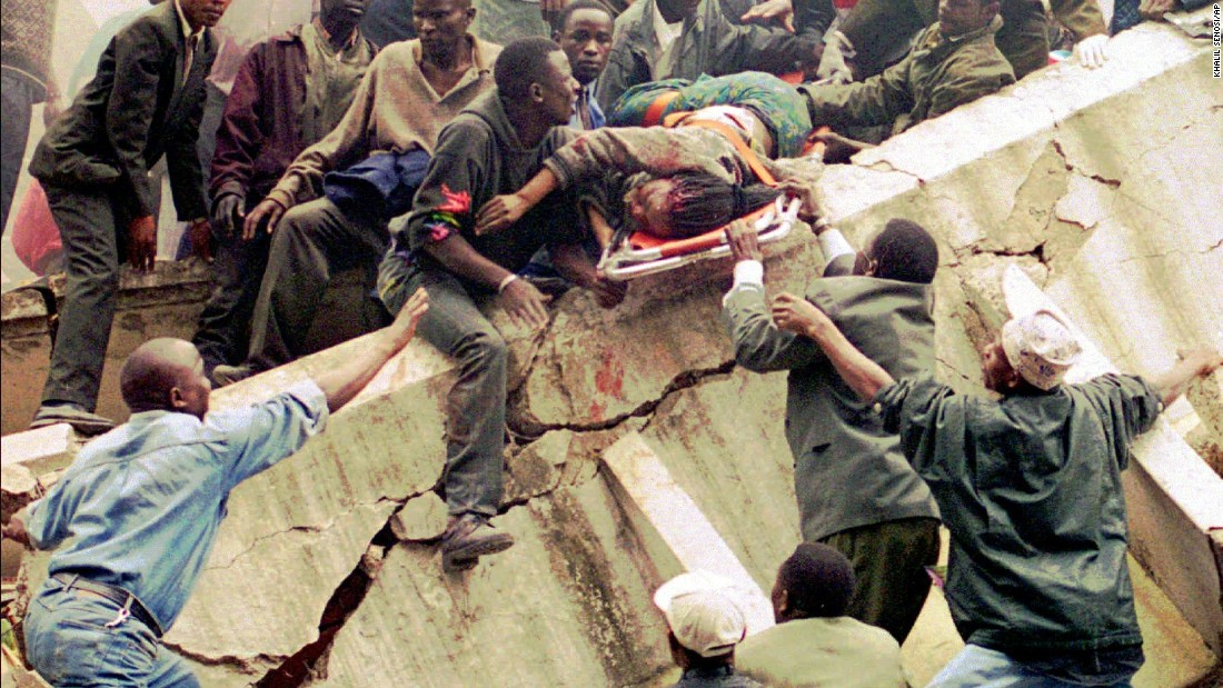 Rescue workers carry Susan Francisca Murianki, a U.S. Embassy office worker, over the rubble of a collapsed building next to the embassy in Nairobi, Kenya, on August 7, 1998.  A huge explosion tore through the embassy around the exact same time a bomb went off at the U.S. Embassy in Dar es Salaam, Tanzania.