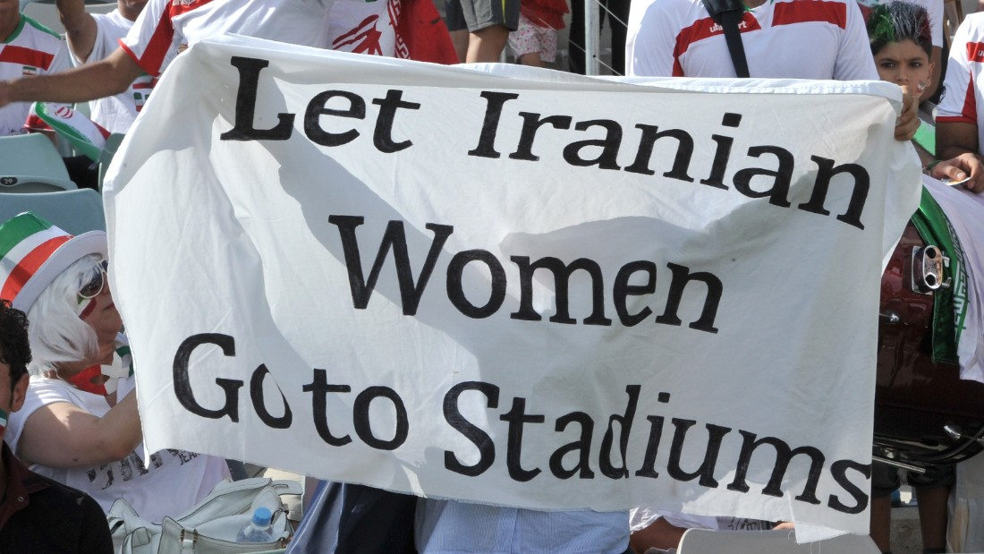 Iranian supporters display a banner calling for an end to Iran's stadium ban on women during the Asian Cup quarterfinal in Canberra.