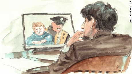 Dzhokhar Tsarnaev during testimony of Officer Thomas Barrett, who picked up Leo, 3, after Boston Marathon bombing.