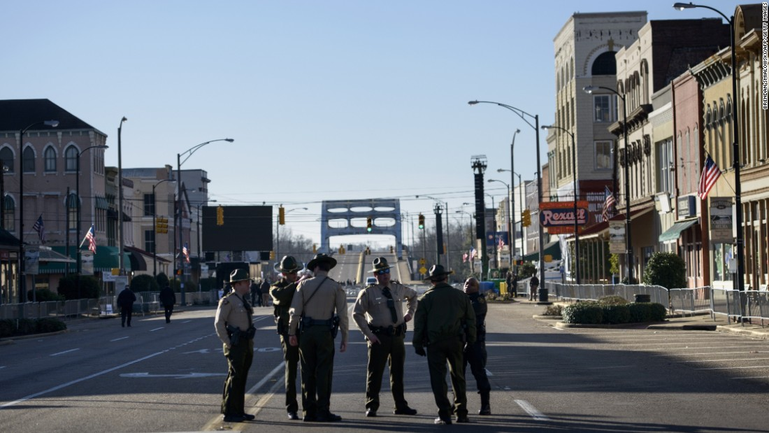 Police officers block Broad Street near the Edmund Pettus Bridge.