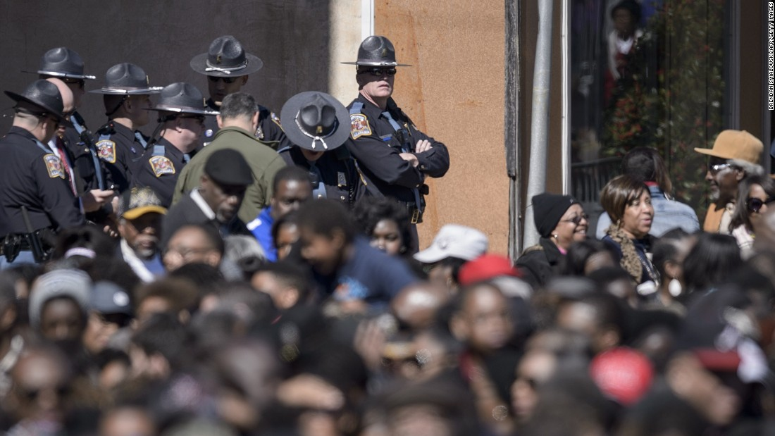 Police watch over the crowd waiting on Broad Street in Selma, Alabama.