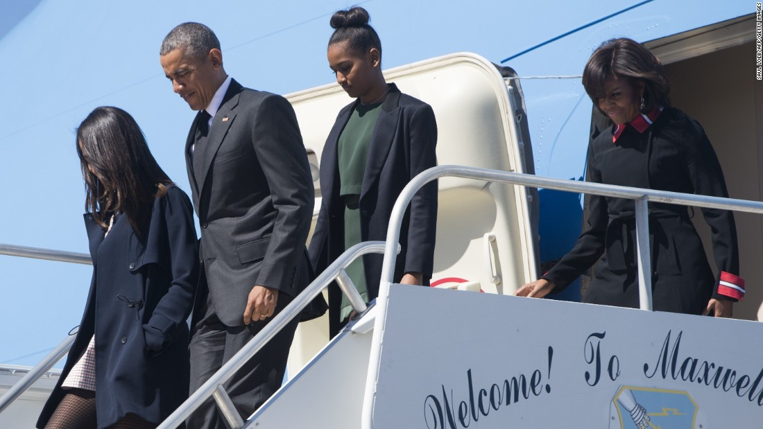 President Obama, first lady Michelle Obama and their daughters, Malia and Sasha, disembark from Air Force One upon arrival at Maxwell Air Force Base in Montgomery, Alabama.