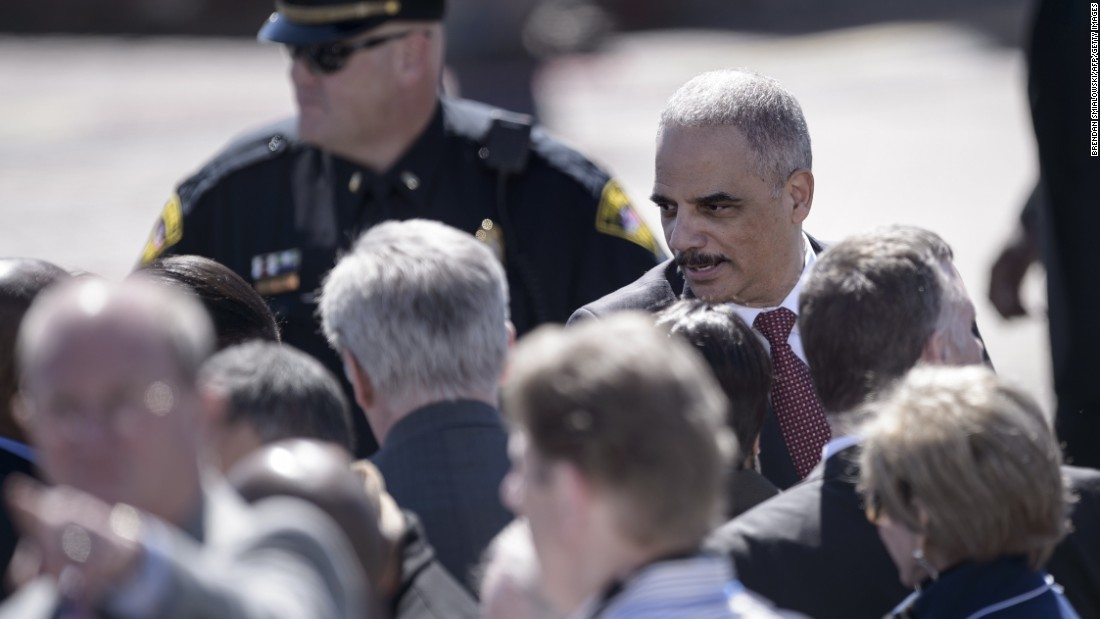 U.S. Attorney General Eric H. Holder Jr. arrives at the Edmund Pettus Bridge.