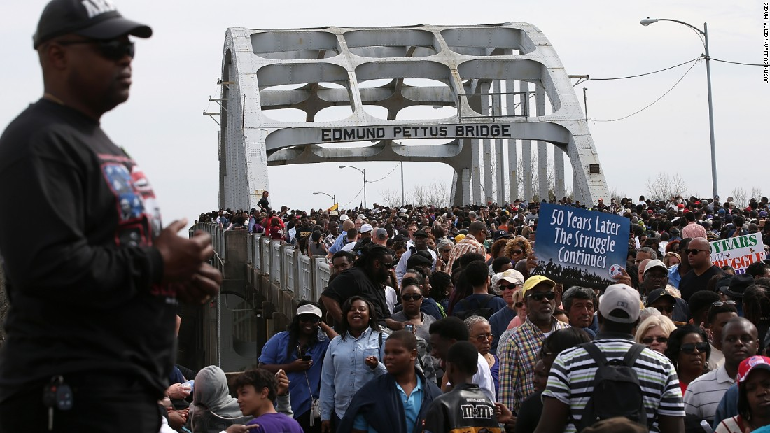 Thousands of people walk across the Edmund Pettus Bridge during the 50th anniversary commemoration of the Selma-to-Montgomery civil rights march on March 8, 2015, in Alabama.  A violent confrontation with police and state troopers on the bridge in 1965 is one of the most memorable events of the civil rights movement. Click through the gallery for more images of the commemoration: