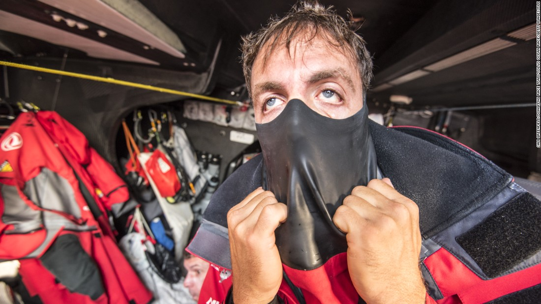 "Sailor Eric Peron pulls on waterproof gear during the Volvo Ocean Race -- a competition described as the ""Everest of Sailing."""