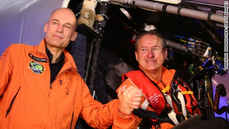 Swiss pilot Bertrand Piccard and his compatriot pilot Andre Borschberg pose for a picture before flying with the Solar Impulse 2 from al-Bateen airport in Abu Dhabi on March 9, 2015.