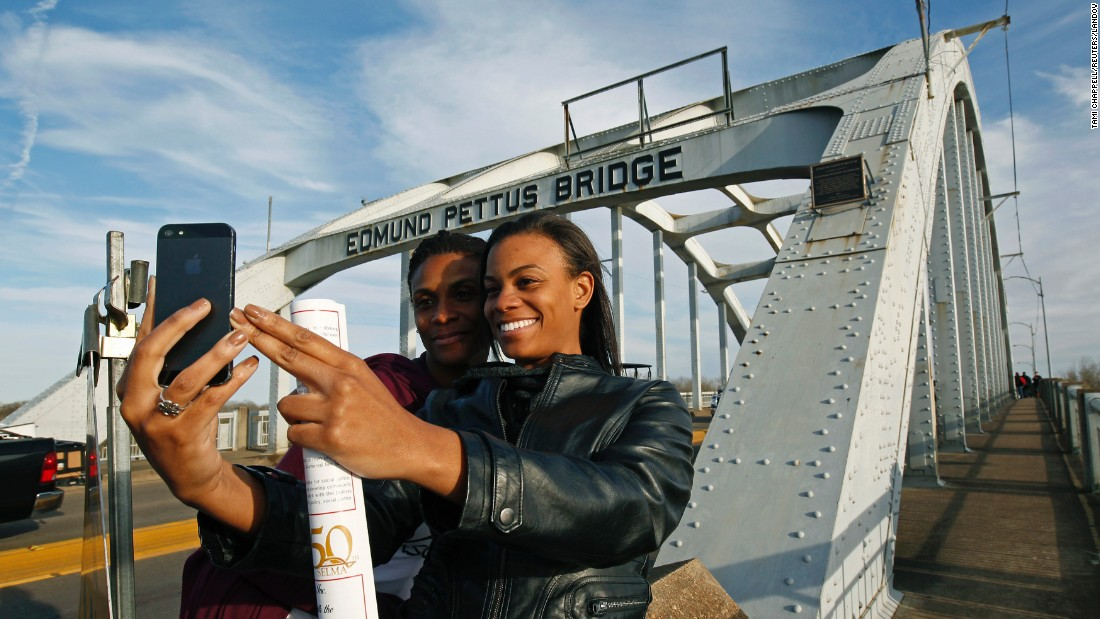 "Lazette Bowens, left, and her daughter Zoe take a selfie at the Edmund Pettus Bridge in Selma, Alabama, on Friday, March 6. Fifty years ago, state troopers <a href=""http://www.cnn.com/2015/01/06/us/gallery/selma-bloody-sunday-1965/index.html"" target=""_blank"">used brutal force and tear gas at the bridge</a> to push back hundreds of people marching to protest discriminatory practices. What the marchers did years ago ""will reverberate through the ages,"" <a href=""http://www.cnn.com/2015/03/07/us/selma-50-years-anniversary-live-events/index.html"" target=""_blank"">President Obama said</a> on Saturday, March 7. ""Not because the change they won was preordained; not because their victory was complete; but because they proved that nonviolent change is possible; that love and hope can conquer hate."""