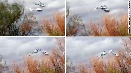 Photo composition showing two helicopters colliding mid-air near Villa Castelli, in the Argentine province of La Rioja on March 09, 2015. The two helicopters collided in northern Argentina, killing 10 people including a group of French sports stars participating in a reality TV show, officials said.