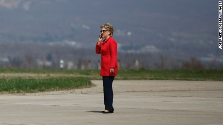Democratic presidential hopeful U.S. Senator Hillary Clinton (D-NY) speaks on the cell phone as she waits to get on her plane at the Scranton airport after holding a campaign rally in the Scranton Cultural Center April 21, 2008 in Scranton, Pennsylvania.