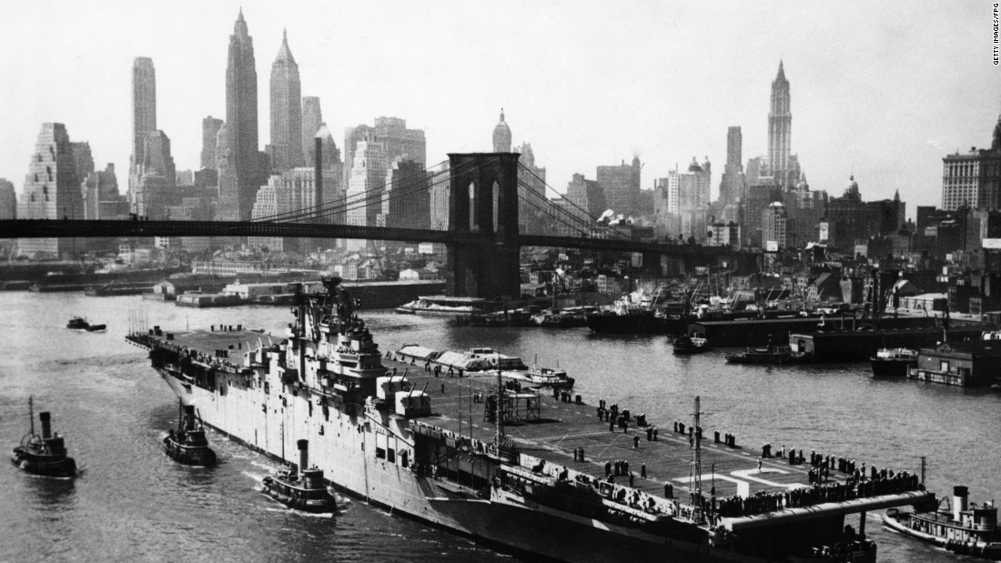 The USS Leyte passes up the East River en route to the Brooklyn Navy Yard in 1948.