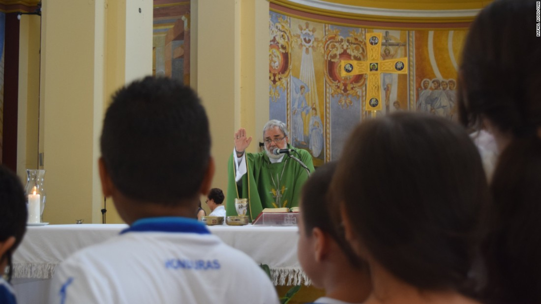 Monsignor Rómulo Emiliani celebrates a mass dedicated to children and peace at the San Pedro Sula Cathedral. Emiliani says the plight of the migrant children is a national and regional disgrace.