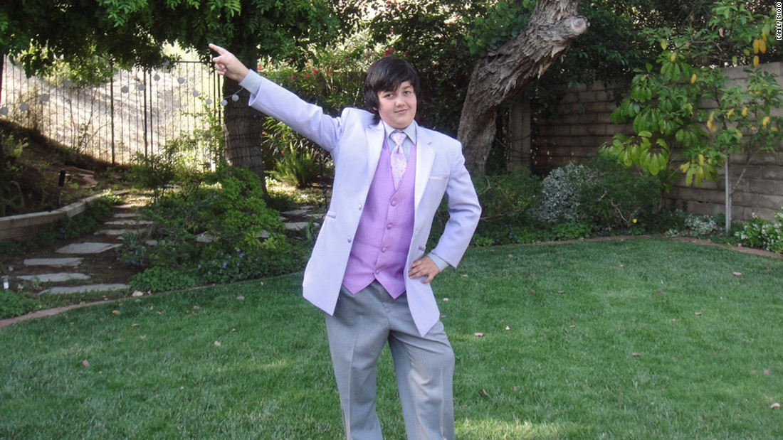 Avery wore a suit with a lavender vest to his fifth-grade graduation party in 2010.