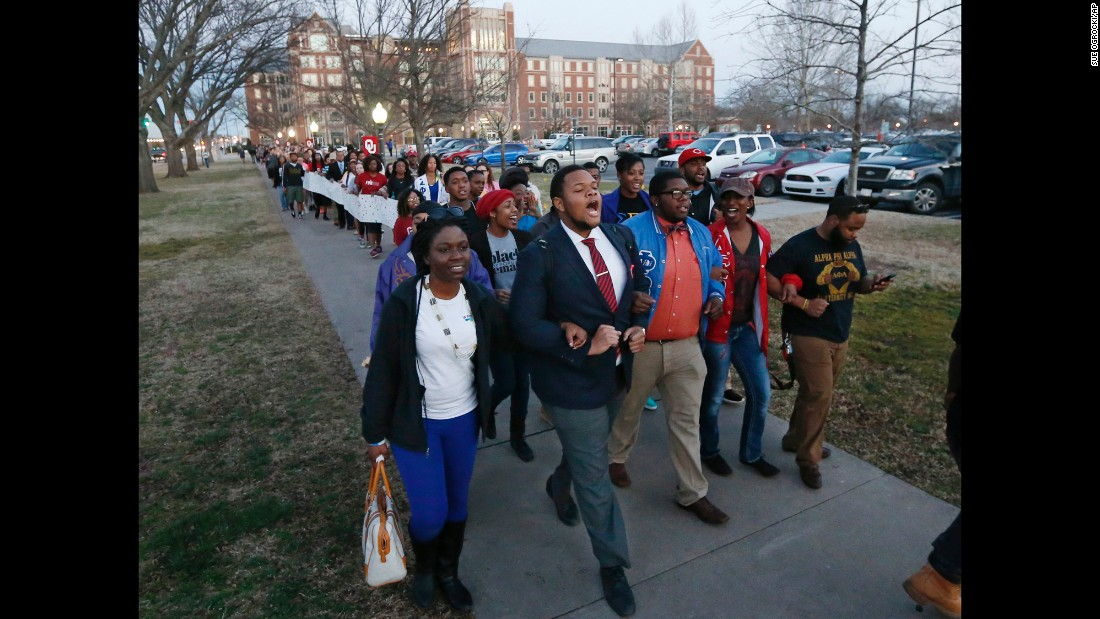 "University of Oklahoma students march to the now-closed fraternity house of Sigma Alpha Epsilon during a rally in Norman, Oklahoma, on Tuesday, March 10. The university's president <a href=""http://www.cnn.com/2015/03/11/us/oklahoma-racist-chant/index.html"" target=""_blank"">expelled two students Tuesday</a> after he said they were identified as leaders of a racist chant that was captured on video."