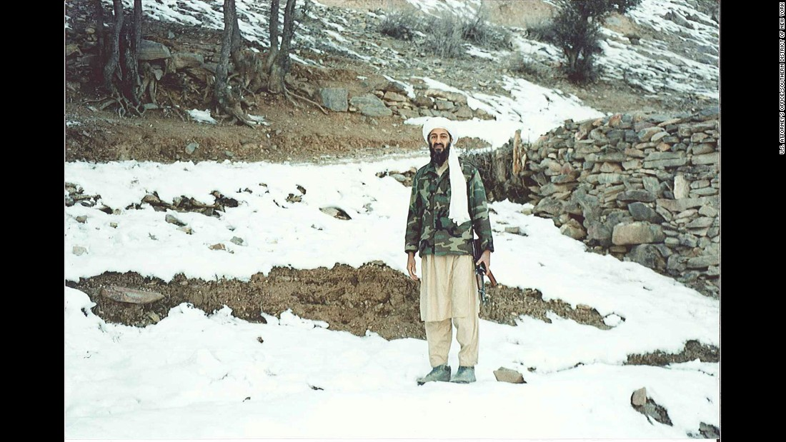 Osama bin Laden holds a Kalashnikov rifle in Tora Bora, a mountainous area of Afghanistan, in November 1996. This remarkable set of photos -- the first showing bin Laden in the remote hideout where he would seek refuge after 9/11 -- came to light only last month in the terrorism conspiracy trial of bin Laden lieutenant Khaled al-Fawwaz. Al-Fawwaz was a communications conduit for al Qaeda in London during the mid-1990s.