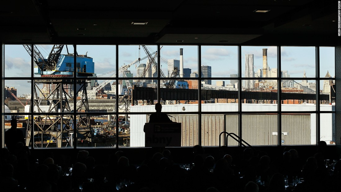 Former New York City Mayor Michael Bloomberg (C) speaks about job creation and the economy to business leaders at Steiner Studios in the Brooklyn Navy Yard, December 2010.