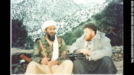 Osama bin Laden, with his Kalashnikov rifle, sits at the base of a Tora Bora mountain with Syrian-born ideologue Abu Musab al-Suri.