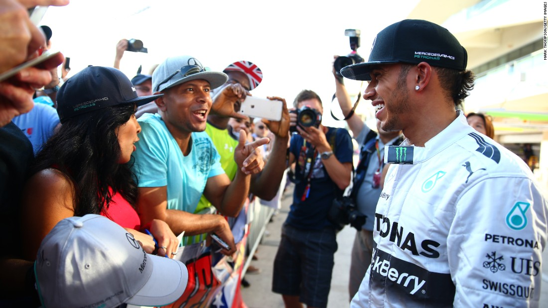 """The reason Lewis is so popular is because he spends a lot of time on social media, he reaches out to his fans and he wears his heart on his sleeve,"" says Hamilton fan Christopher Thomas, seen talking to his hero at the 2014 U.S. Grand Prix."