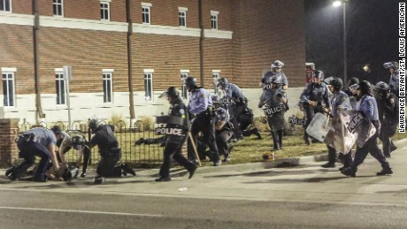 Two police officers were shot during protests outside the Ferguson police department early Thursday, March 12, just hours after the city's police chief resigned.