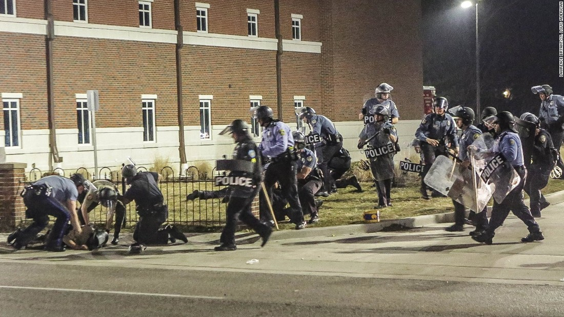 Police respond after the two officers were shot outside the Ferguson Police Department early March 12.
