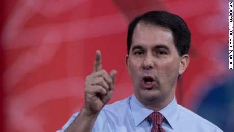 Walker highlights contrast with Bush