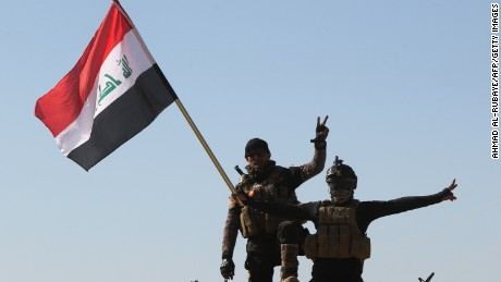 Iraqi government forces take part in a military operation on the western outskirts of the Iraqi city of Tikrit, 160 kms north of Baghdad, to retake control of the city from jihadists from the Islamic state (IS) group, on March 11, 2015. Iraqi forces entered a northern neighbourhood of Tikrit, marking a new stage in the operation launched 10 days ago to wrest the city back from jihadists, army officers said. AFP PHOTO / AHMAD AL-RUBAYE (Photo credit should read AHMAD AL-RUBAYE/AFP/Getty Images)