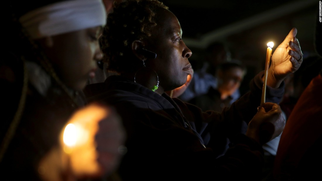 People take part in a candlelight vigil Thursday, March 12, in Ferguson, Missouri.