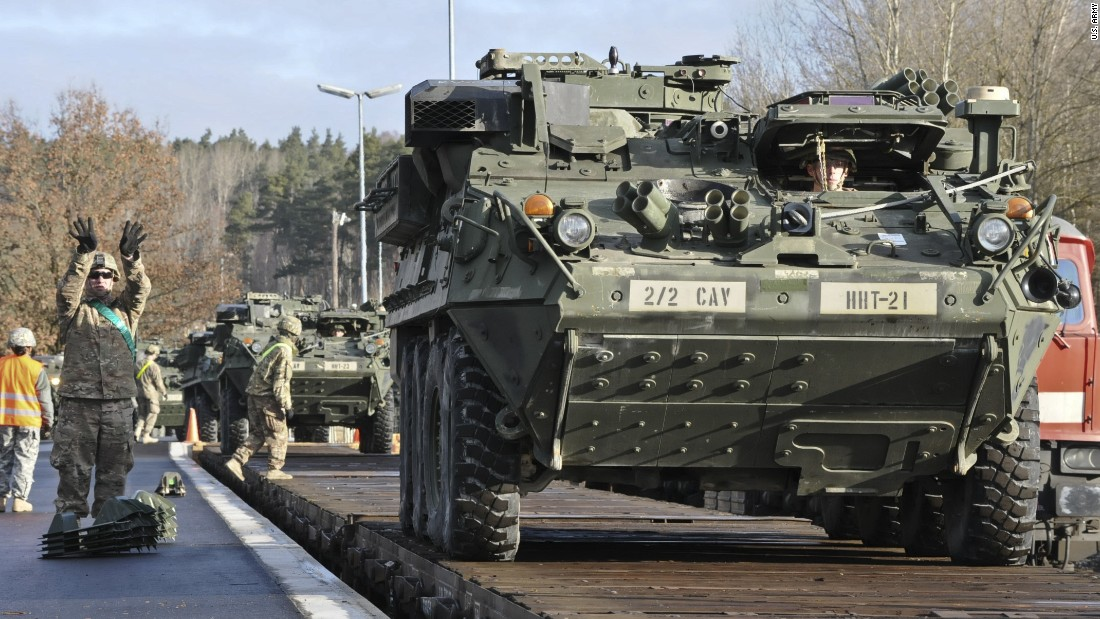 Dragoons assigned to Head Hunter Troop, 2nd Squadron, 2nd Cavalry Regiment load their Strykers and equipment onto a local railway as they prepare for their upcoming rotation in support of Operation Atlantic Resolve at Rose Barracks, Germany, March 11, 2015.