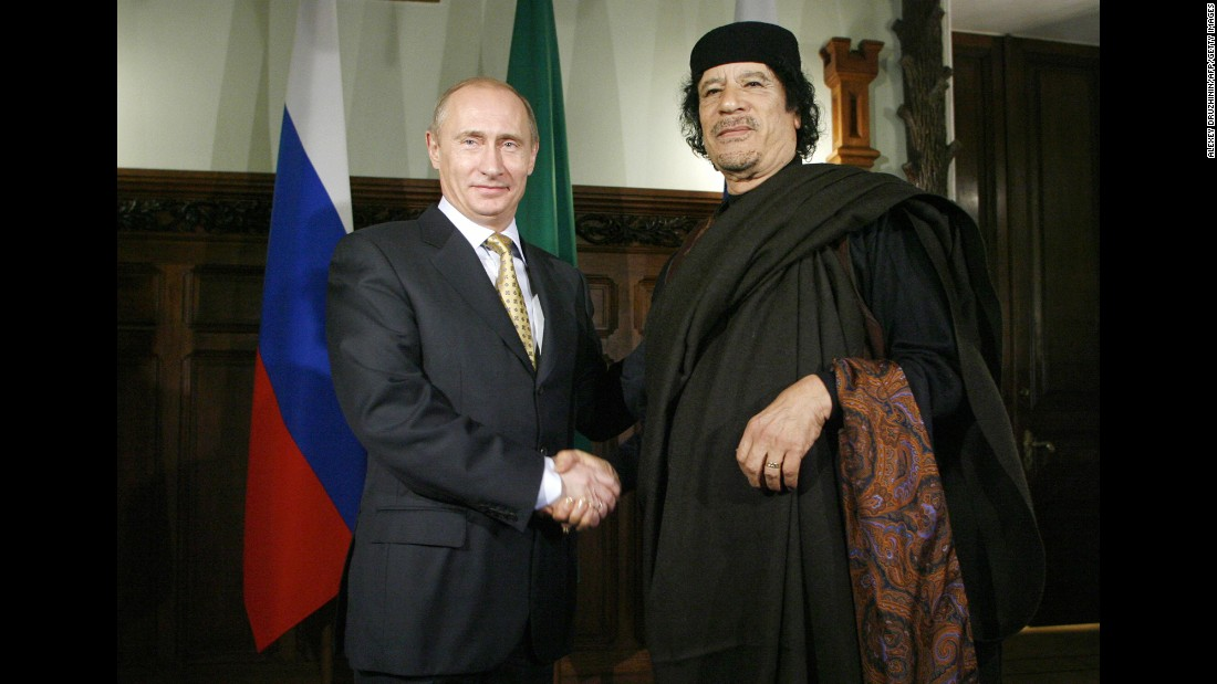 Putin shakes hands with Libyan leader Moammar Gadhafi in November 2008.
