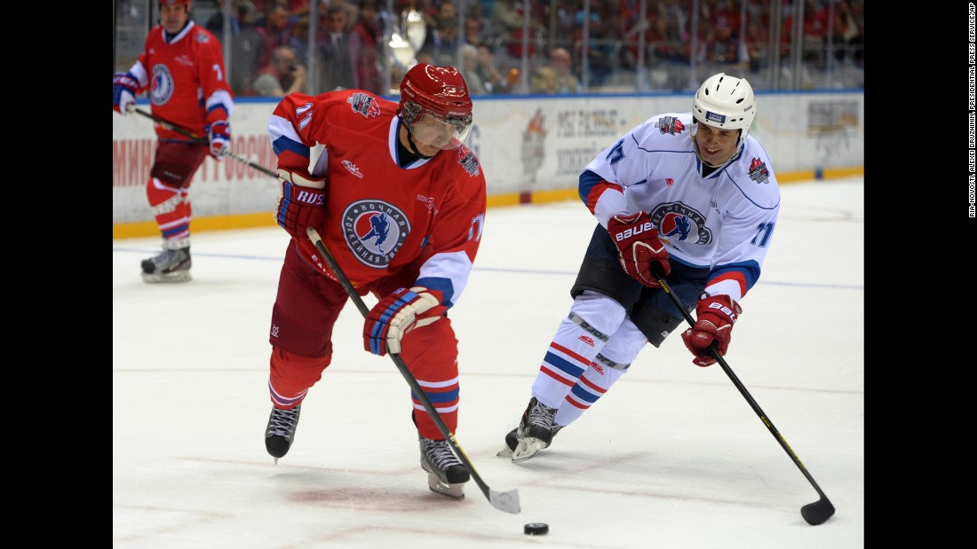Putin controls the puck during an ice hockey game between Russian amateur players and ice hockey stars at a festival in Sochi, Russia, in May 2014.