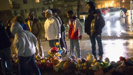 Demonstrators visit the Michael Brown memorial to say a prayer on Friday, March 13 in Ferguson, Missouri.