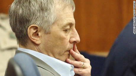 Caption:GALVESTON, TX - NOVEMBER 10: Millionaire murder defendant Robert Durst (C) sits in State District Judge Susan Criss court with his attorney Dick DeGuerin (R) November 10, 2003 at the Galveston County Courthouse in Galveston, Texas. Durst is being charged for the murder and mutilation of his neighbor Morris Black. (Photo by James Nielsen/ Getty Images)