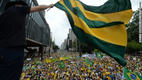 Demonstrators rally to protest against the government of president Dilma Rousseff in Paulista Avenue in Sao Paulo Brazil on 15 March 2015. Thousands of demonstrators clad in the yellow-green national colours protested Sunday in several cities of Brazil against president Dilma Rousseff who is facing a complex economic panorama and a political corruption scandal.