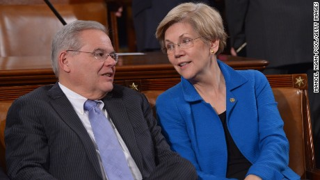 Senators Warren and Bob Menendez (D-NJ) talk before the State of the Union address by President Obama on January 20, 2015 in the House Chamber of the U.S. Capitol.