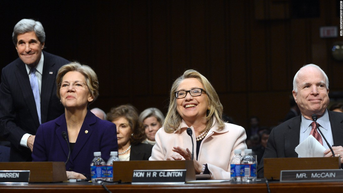 (Left to right): John Kerry, Warren, then-Secretary of State Hillary Clinton and Sen. John McCain, are seated at Kerry's State Department confirmation hearings on Capitol Hill on January 24, 2013.
