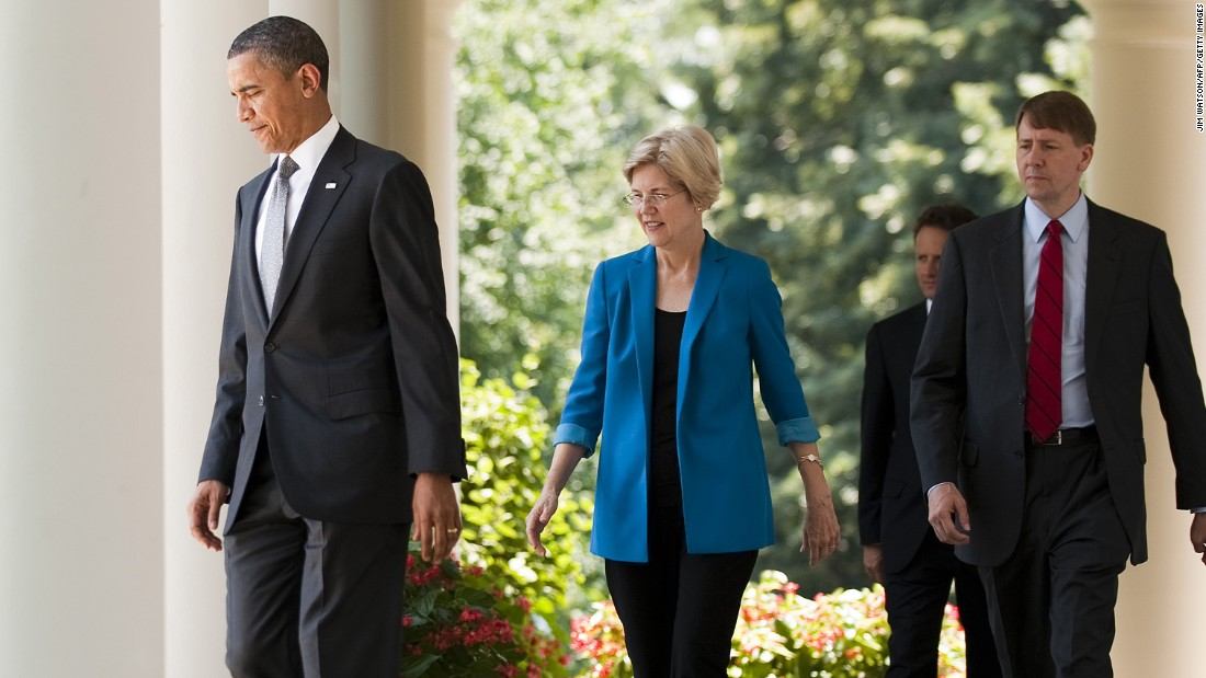 President Obama (left) and former financial adviser Elizabeth Warren (left) arrive at the nomination of former Ohio Attorney General Richard Cordray (right) to lead a consumer protection bureau at the White House on July 18, 2011.