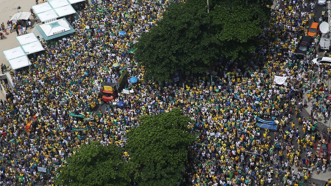 In Rio de Janeiro, they gathered along Copacabana beach, as pictured. In the capital, Brasilia, protesters marched on government headquarters.