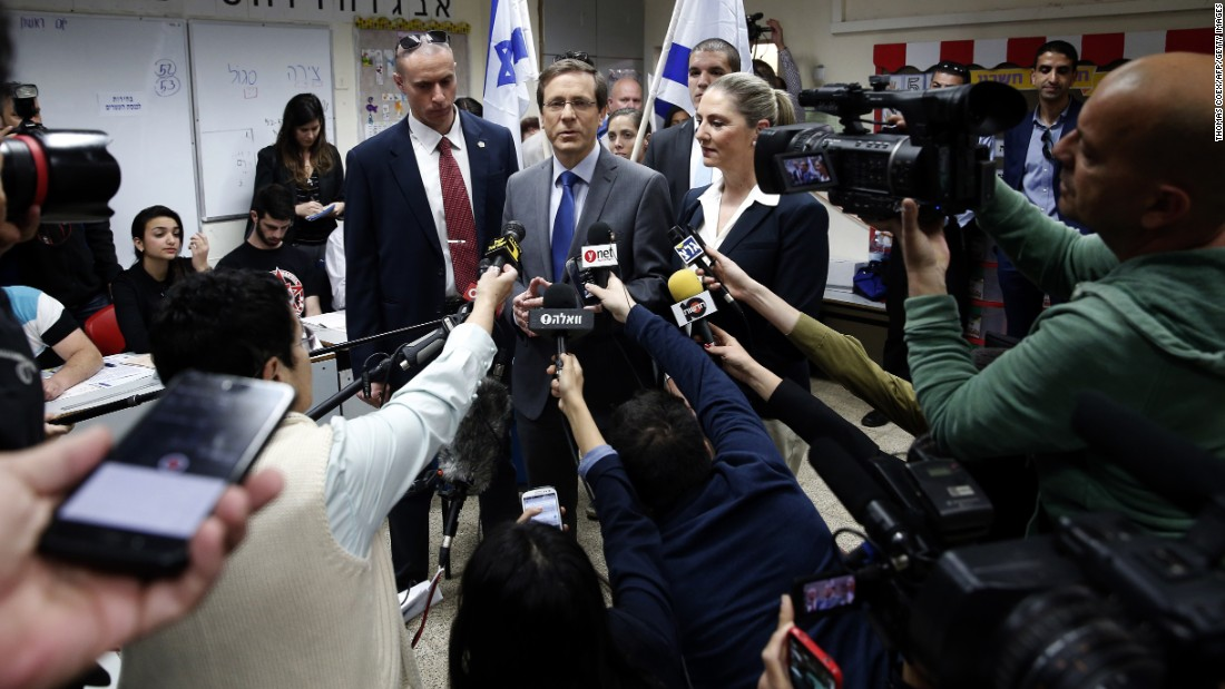 Herzog talks to the media after voting in Tel Aviv on March 17.