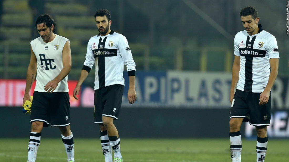Alessandro Lucarelli (L), Raffaele Palladino (C) and Zouhair Feddal of Parma look dejected at the end of a 1-0 home loss to AC Chievo Verona on February 11. The players have not been paid all season.