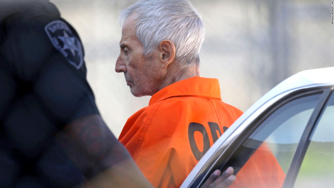 "Robert Durst, a wealthy New York real-estate heir, is escorted into Orleans Parish Prison after his arraignment in New Orleans on Tuesday, March 17. Durst faces felony firearm and drug charges in New Orleans, and he has been charged with first-degree murder in Los Angeles. Investigators say they believe Durst, 71, was behind the slaying of Susan Berman, Durst's longtime friend. Durst is also the focus of the HBO documentary series ""The Jinx,"" which explores his wife's 1982 disappearance and investigators' suspicions that Berman was killed because she knew what happened to her. Durst has long maintained he didn't kill Berman or have anything to do with his wife's disappearance."