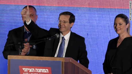 Co-leader of the Zionist Union party, Israeli Labour Party leader Isaac Herzog (C), delivers a speech as he reacts to exit poll figures in Israel's parliamentary elections late on March 17, 2015 in the city of Tel Aviv. Israeli Prime Minister Benjamin Netanyahu's rightwing Likud party is neck-and-neck with the centre-left Zionist Union, exit polls say. AFP PHOTO / THOMAS COEXTHOMAS COEX/AFP/Getty Images
